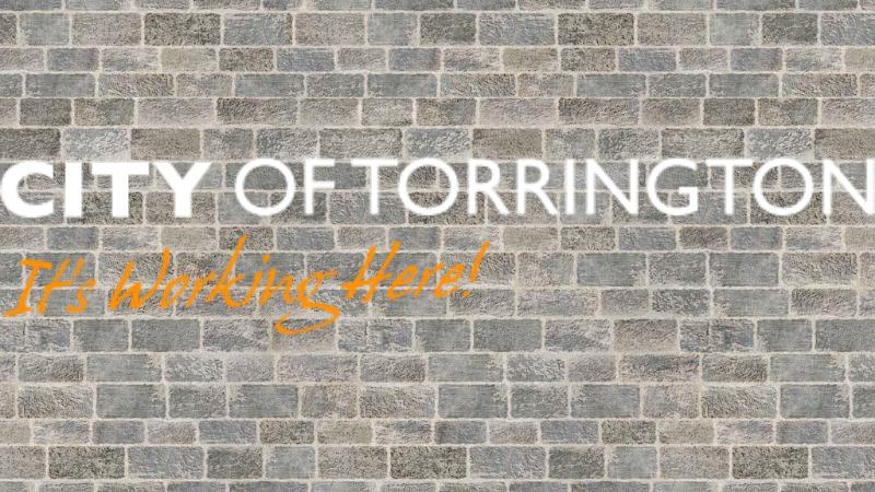 City of Torrington logo with brick background